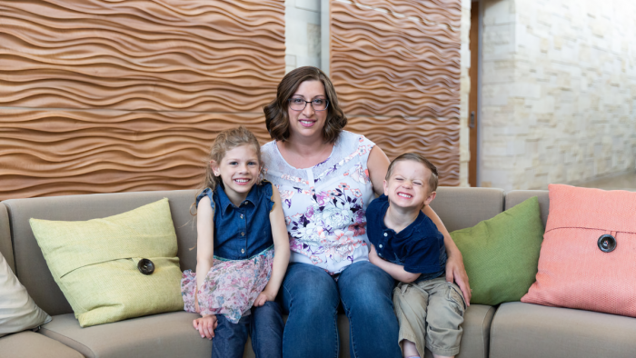 Katrina Mader and her kids at the Workiva Ames office (pre-COVID)